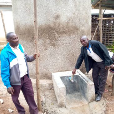 Rainwater Collection System Constructed in Village on Lake Bunyonyi Surrounding Hills.